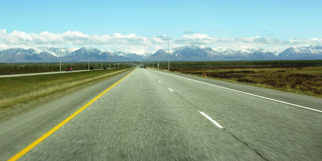 The Journey Begins: View from the van's front seat on the way into Wasilla