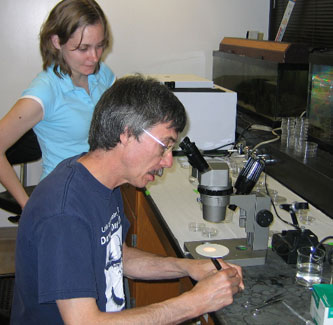 Prof. Baker and Jenna working in the lab, Alaska, 2006.
