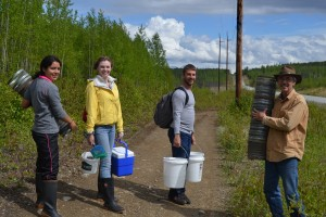 Cynthia, Emma, Ryan, and John carrying traps, buckets, and samples out of Whale Lake