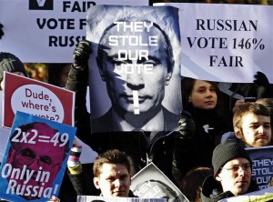 Russian residents in Britain demonstrate outside Britain's Houses of Parliament in London December 10, 2011. REUTERS/Luke MacGregor